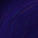 Star trails in night sky. Long exposure sky motion effect. Stock Images