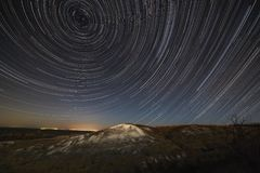 Star trails in the night sky. A view of the starry space royalty free stock images