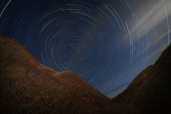 Star trails in the night sky. A view of the starry space royalty free stock photo