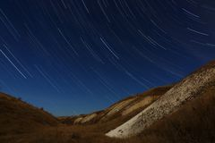 Star trails in the night sky. A view of the starry space royalty free stock photography