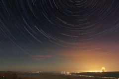 Star trails in the night sky. A view of the starry space stock photo