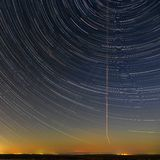 Star trails in the night sky. A view of the starry space stock image