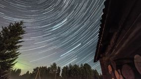 Star trails. Night time-lapse over old village. Star Trails Night Sky Cosmos Galaxy Time-lapse over old village. Amazing high resolution night lapse at stock video footage