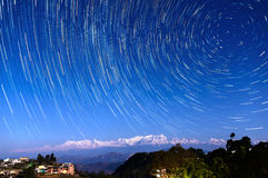 Star trails over Bandipur, Nepal. Star trails over Bandipur village and the Himalayas, Nepal Stock Photography