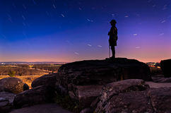 Star trails over boulders and statue on Little Round Top at nigh Royalty Free Stock Images