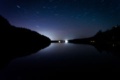 Star trails over Echo Lake, in Acadia National Park, Maine. Stock Photo