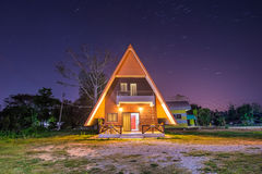 Star trails over house, Chiangrai Stock Image