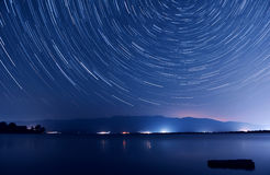 Star trails over the lake