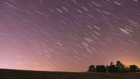 Star trails over landscape with light pollution. This represents 20 minutes of time passing, so the stars are streaked across the sky Royalty Free Stock Photography