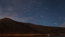 Star trails over mountain Stock Images