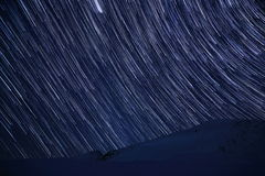 Star trails over mountains in winter time Royalty Free Stock Photography