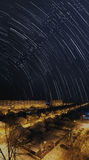 Star trails over night city Royalty Free Stock Photography
