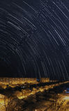 Star trails over night city Royalty Free Stock Image