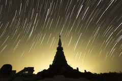 Star trails over the pagoda, Thailand. Stock Image