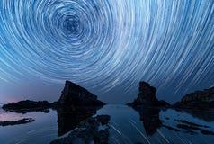 Star trails over the rock phenomenon The Ships. Bulgaria Stock Image