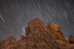 Star trails over Roque de Garcia in Teide national park, Tenerife, Canary island, Spain. Royalty Free Stock Image