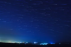 Star trails over the suburbs Stock Images