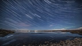 Star trails over waterfront