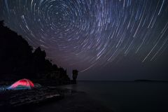 Star Trails above Flowerpot. Star Trails on a rocky beach above a flowerpot on an island royalty free stock image