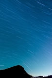 Star Trails with silhouette of mountain Royalty Free Stock Photography