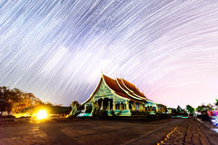 Star trails at the Thai church. / star trails on the sky stock photos