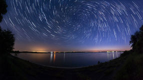 Star trails with zoom effect  at the lake side Royalty Free Stock Photo