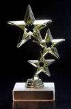 Star Trophy. With blank id plaque on black background Stock Photography