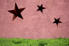 Star on wall background Stock Photos