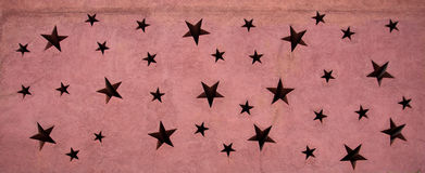 Star on wall background Royalty Free Stock Photography