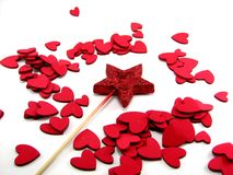 Star wand with hearts. Red star wand with various sized hearts scattered around it stock photo