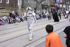 The Star Wars character Stormtrooper Pilot waves to children along the Queen St E Toronto during the Beaches Easter Parade 2017 stock image