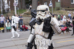 The Star Wars character Stormtrooper walks along the Queen St E Toronto during the Beaches Easter Parade 2017 Royalty Free Stock Photography