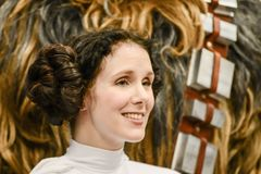 Star wars characters on comic con convention. Photographed in close-up. Happy visitors pose happy with their idols. leia and chewbacca and moore royalty free stock image