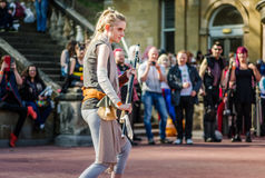 Star Wars cosplay. Scarborough, UK - April 08, 2017: Female cosplayer dressed as `Rey` from `Star Wars` poses during a cosplay competition at Sci-Fi Scarborough Royalty Free Stock Images