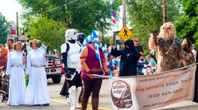 Star Wars marchers. TWINSBURG, OH, USA - AUGUST 8, 2015: Twins and others dressed as characters from Star Wars walk in the Double Take Parade, part of the 40th Royalty Free Stock Images