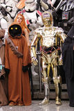 Star wars personnage at Comic con in Montreal. MONTREAL-CANADA SEPT 13 2014: Fan disguise in C3P0 golden robot and a jawa from Star wars at Comic con experience stock photography