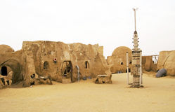 Star Wars in the Sahara desert. Abandoned sets for the shooting of the movie Star Wars in the Sahara desert on a background of sand dunes Stock Photos