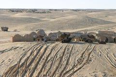 Star Wars scenerii Ong Jemel blisko Nefta z niewiadomymi piasków ludźmi Obrazy Stock