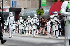 Star Wars Storm Troopers Walk In Atlanta Dragon Con Parade. Atlanta, GA, USA - August 31, 2013:  A group of Star Wars storm troopers walks by spectators at the Royalty Free Stock Images