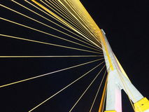 The star with yellow line of the bridge from thailand. The star with yellow line of the RAMA 8 bridge from thailand with dark sky background stock photography