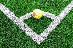 Stara żółta piłki nożnej piłka Zdjęcia Stock