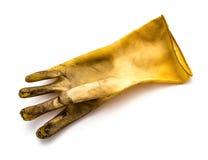 Stara brudna i łamana pvc rękawiczka na białym tle Obrazy Stock