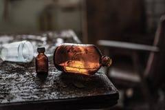 Stara butelka glycerin jest na stole zdjęcia stock