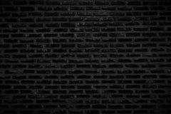 Stara Ciemnego czerni ściany z cegieł tekstura i tło obrazy stock