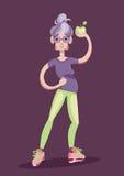 Stara dama w sportach jest ubranym z zielonym jabłkiem w ręce Obrazy Royalty Free
