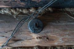 Stara elektryczna zmiana na drewnianej ścianie Fotografia Royalty Free