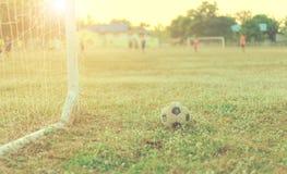 Stara futbolowa rocznik fotografia z piłka nożna celem z obiektywu racy skutkiem Fotografia Stock