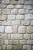 Stara kamienna ściana z zaokrąglonym wapniem brukuje tło Fotografia Stock