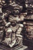 Stara kamienna statua bali Indonesia Obrazy Royalty Free