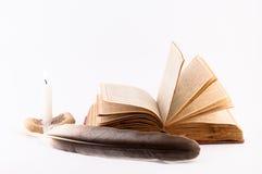 Stara książka, świeczka i piórko, Obraz Stock